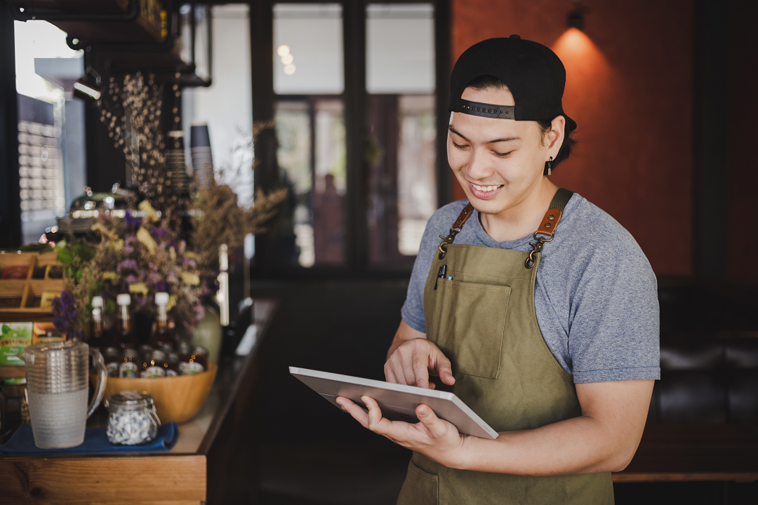 asian-man-barista-holding-tablet-checking-order-from-customer-coffee-cafe
